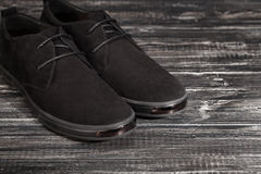 Black man`s shoes on gray background. Black man`s shoes on gray background, selective focus Royalty Free Stock Image