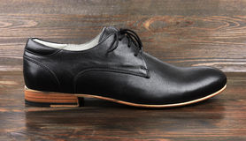Black man's shoes on wood Stock Photography