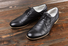 Black man's shoes on wood Stock Image