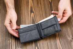 Black man's wallet in man hands Royalty Free Stock Images