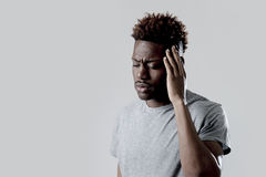 Black man in sad and tired face expression looking exhausted suffering headache. Young attractive afro american black man in sad and tired face expression stock photos