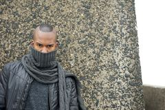 Black man with scarf covering face outdoors Stock Photo