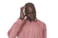 Black man scratching his head Stock Photos