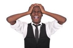 Black man screaming with headache Stock Photo