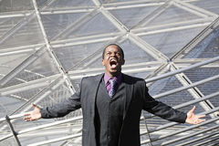 Black man screaming tired of business network Stock Photo