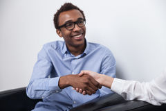 Black man shaking hands Royalty Free Stock Image