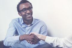 Black man shaking hands, toned Royalty Free Stock Photos