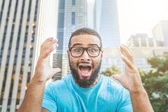 Black man shouting at camera Stock Image