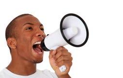 Black man shouting through megaphone. Attractive black man shouting through megaphone. All on white background Royalty Free Stock Images