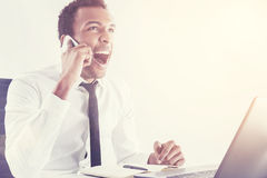 Black man shouting on mobile phone Stock Photography
