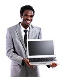 Black man showing laptop isolated on white Stock Image