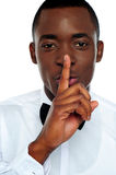 Black man showing silence gesture Royalty Free Stock Photos