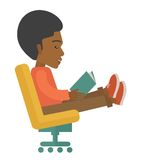 Black Man sitting with a book Stock Photo
