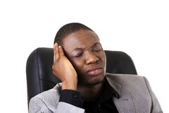 Black man sitting at work Stock Photography