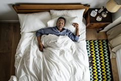 Black man sleeping in bed Royalty Free Stock Image