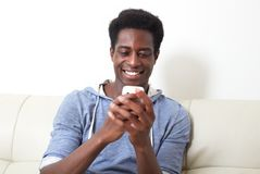 Black man with smartphone Royalty Free Stock Photos
