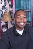 Black man smiling Stock Images