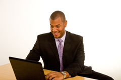 Black Man Smiling Working on Laptop royalty free stock photo