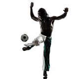 Black man soccer player juggling football silhouet Stock Photography