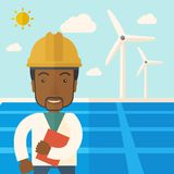 Black man in solar panel and windmills Royalty Free Stock Photo