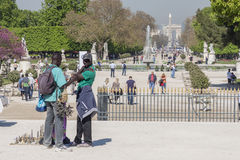 Black man souvenirs seller in Jardin des Tuileries - Paris, Fran Royalty Free Stock Photo