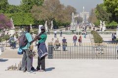 Black man souvenirs seller in Jardin des Tuileries - Paris, Fran Royalty Free Stock Photo