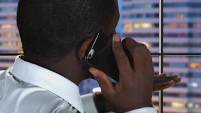 Black man speaking on phone. stock footage