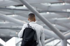 Black man standing in airport with bag Royalty Free Stock Images