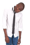 Black man standing and feeling miserable. Young blackman standing and feeling miserable stock photo