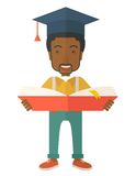 Black man standing with graduation cap Stock Image