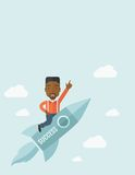 Black man in start up business. A black man with a beard flying on the rocket raising his hand in the air as his start up. Success concept. A Contemporary style Stock Photography
