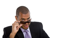 Black Man in Suit Looking Over Sunglasses Royalty Free Stock Photos