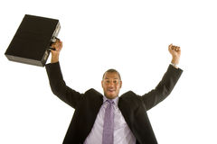 Black Man in Suit Raising Fist and Briefcase Royalty Free Stock Images