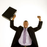 Black Man in Suit Raising Fist and Briefcase stock photo