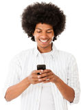 Black man texting on his phone Stock Image