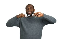 Black man with toothpaste and brush. royalty free stock photos
