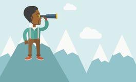Black man on top of blue mountain Royalty Free Stock Photo