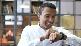 Black Man Using Smartwatch in Office. Designer , young man , handsome stock video