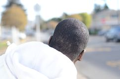 Black Man Waiting For Bus. During the day Royalty Free Stock Photography