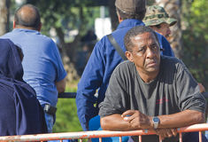 Black Man Waits For Medical Care At Free Clinic. Los Angeles, USA - October 17, 2011:  People without medical insurance wait in long lines that stretch around Stock Photo