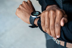 Black man with watch on his hand Royalty Free Stock Photo