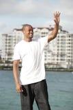 Black man waving Stock Image