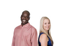 Black man and white blond woman laughing. Young mixed couple black men and blond caucasian women standing back to back in studio on a white background Stock Photography