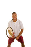 Black Man in White Shirt in Tennis Stance royalty free stock photography