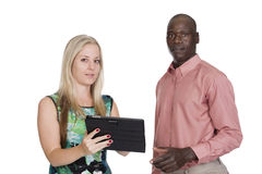 Black man and white woman and a tablet Stock Image