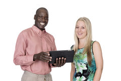 Black man and white woman and a tablet Royalty Free Stock Images