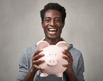 Free Black Man With Piggy Bank. Royalty Free Stock Photography - 81876847