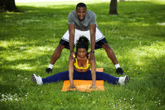 Black Man and Woman Exercising in Park Royalty Free Stock Image