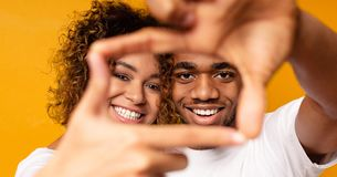 Black man and woman show frame sign with hands royalty free stock photos