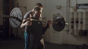 Black man working out with personal trainer royalty free stock photo